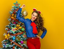 Happy trendy woman showing Christmas ball Royalty Free Stock Photos