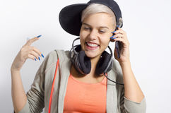 Happy trendy, young girl smiling while talking on phone Royalty Free Stock Photos