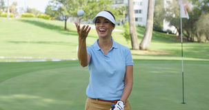 Happy triumphant golfer tossing the ball Stock Image