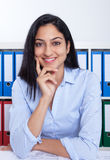 Happy turkish businesswoman at office royalty free stock photography