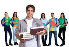 Happy turkish young adult man with other students royalty free stock images