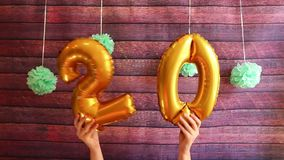Happy twenty birthday with golden number 20 air balloons, anniversary stock video footage