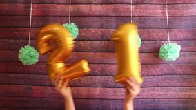 Happy twenty one birthday with golden number 21 air balloons, celebration