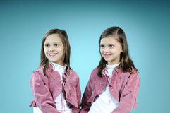 Happy twin girls smiling Stock Image