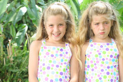 Happy Twin Sad Sister Royalty Free Stock Image