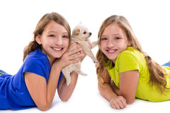Happy twin sister kid girls and puppy dog lying Royalty Free Stock Photography