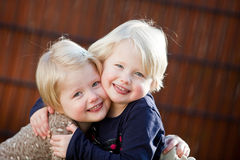 Happy twin sisters smiling. Happy blonde twin sisters smiling having fun Royalty Free Stock Photos