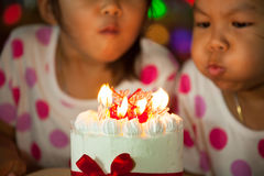 Happy twin two asian little girls celebrating birthday Stock Photography