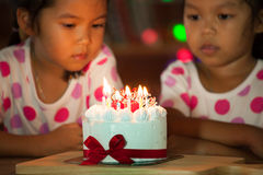 Happy twin two asian little girls celebrating birthday Royalty Free Stock Image