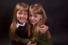 Happy twins. Twin siblings hug and smile stock photos