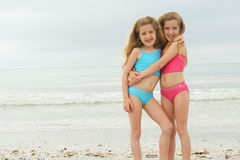 Happy twins at the beach. Shot of happy twins at the beach Stock Photos
