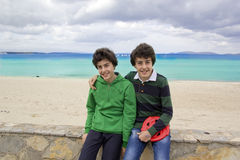 Happy twins are at the beach Stock Photography