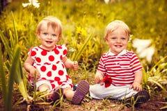 Happy twins boy and girl