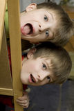 Happy twins brothers shouting stock images