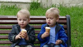 Happy twins eating an ice cream stock footage