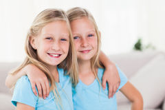 Happy twins embracing each other Stock Photo
