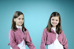 Happy twins posing in studio Royalty Free Stock Image