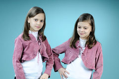 Happy twins posing in studio Royalty Free Stock Photography