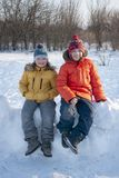 Happy two boys in snow play and smile sunny day outdoors.  stock image