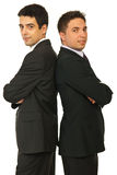 Happy two business men. Standing back to back with arms folded isolated on white background Royalty Free Stock Photos
