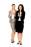 Happy two businesswomen applauding. Royalty Free Stock Photography