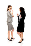 Happy two businesswomen making fists. Stock Photography