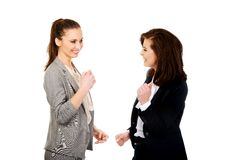 Happy two businesswomen making fists. Royalty Free Stock Photos