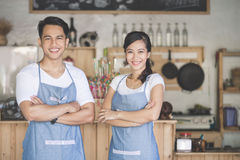 Happy two cafe owner. Successful small business owner proudly standing in front of their cafe Stock Photography