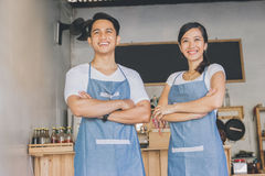 Happy two cafe owner. Successful small business owner proudly standing in front of their cafe stock images