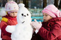 Happy two child with snowman Stock Image