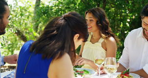 Happy two couples enjoying lunch. At outdoor restaurant stock footage
