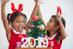 Happy two cute asian child girls with numbers 2019 stock photos