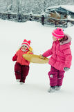 Happy two girl in winter outdoors. Royalty Free Stock Photos