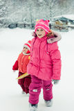 Happy two girl in winter outdoors. Royalty Free Stock Photography