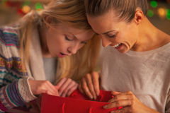 Happy two girlfriends exploring bags after shopping Stock Image