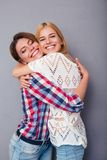 Happy two girls hugging Stock Photography