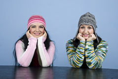 Happy two girls staring. Two happy girls staring you and holding hands on face over blue background,check also my photos in this collection Winter people Stock Photography