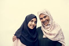 Happy two muslim students with smiling faces stock images