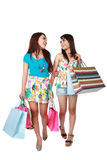 Happy two shopping girl holding bags Stock Image