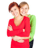 Happy two teenage girls, friends. Two teenage girls, friends hugging on the white background Stock Photos