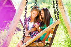 Happy two teenage girls outdoors & mobile phone Stock Photo