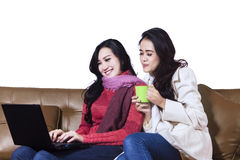 Happy two woman using a laptop Stock Images
