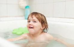 Happy two-year child bathes in bathtub Royalty Free Stock Photography