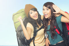 Happy two young girl going on vacation stock photos