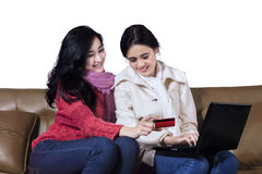 Happy two young girl shopping online Royalty Free Stock Photo