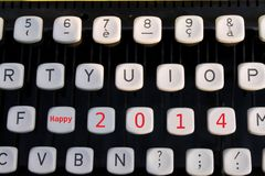Happy 2014 on typewriter. Detail of an old typewriter for happy new year 2014 stock images