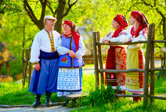 Happy ukrainian family, dressed in national costumes, talking on the street Royalty Free Stock Photography