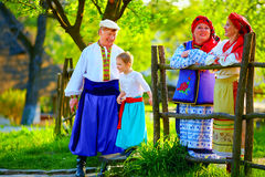Happy ukrainian family in traditional costumes talking outdoor Royalty Free Stock Image