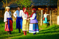 Happy ukrainian family in traditional costumes talking outdoor Royalty Free Stock Photography