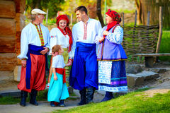 Happy ukrainian family in traditional costumes on their homestead Royalty Free Stock Photo